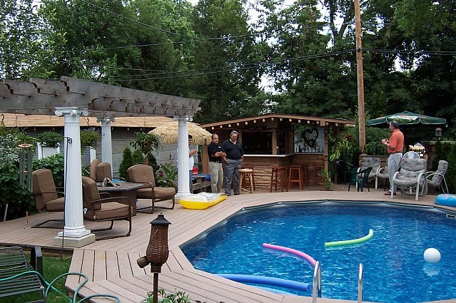 Above ground pool landscaping design ideas pool design ideas for Pool garden ideas