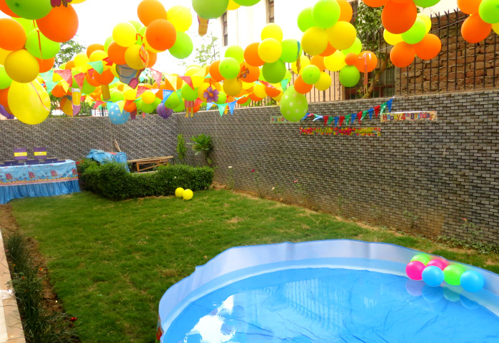 Pool Party Ideas Kids mini beach balls and sunglasses are a must for this colorful pool party via karas party Baby Pool Party Ideas