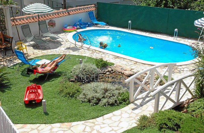 Backyard landscaping ideas with swimming pools pool for Back garden swimming pool
