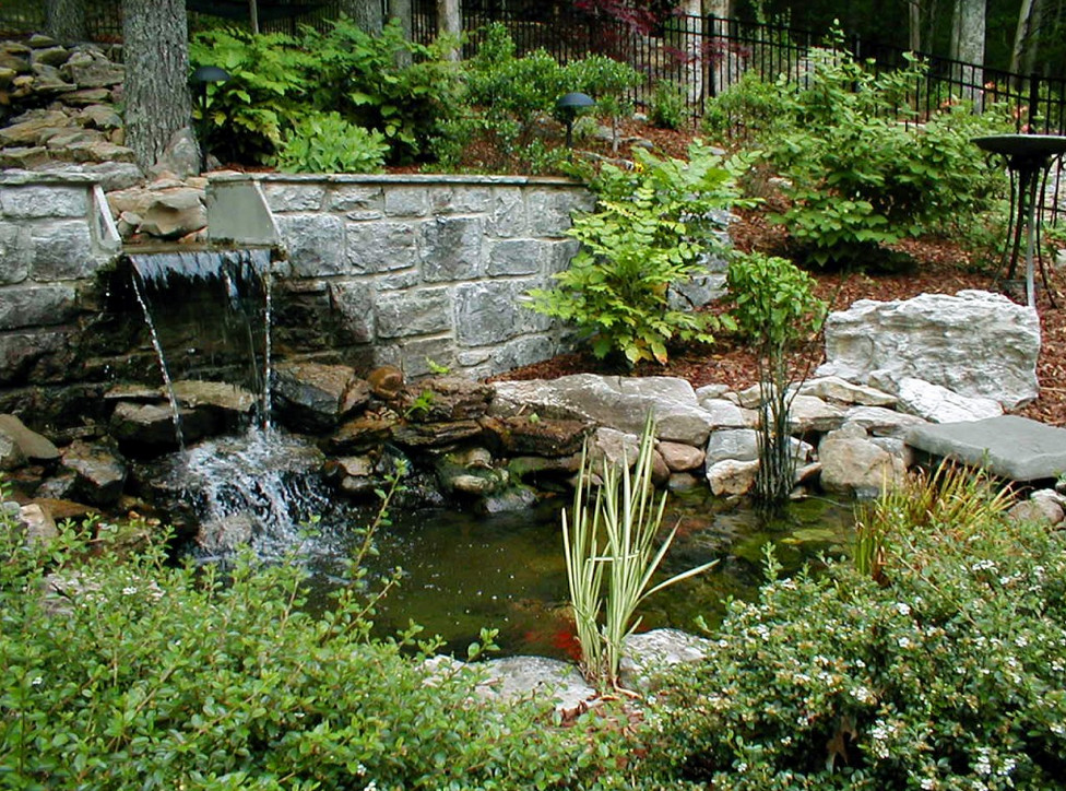 Backyard water features waterfalls pool design ideas for Waterfall water feature