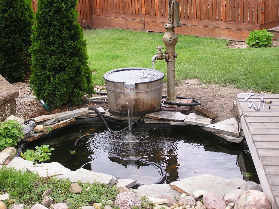 How to landscape around a pond pool design ideas for Landscaping around a small pond