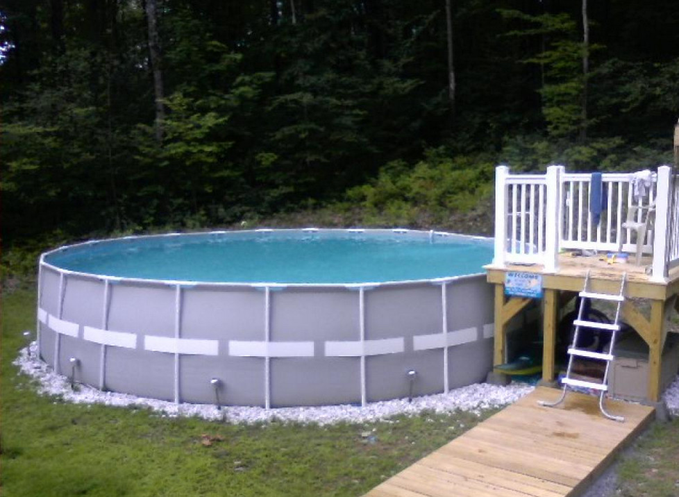 Small decks for above ground pools pool design ideas for Above ground pool designs