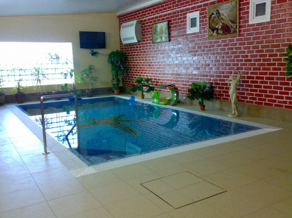 Small indoor pool cost pool design ideas for Indoor swimming pool cost to build