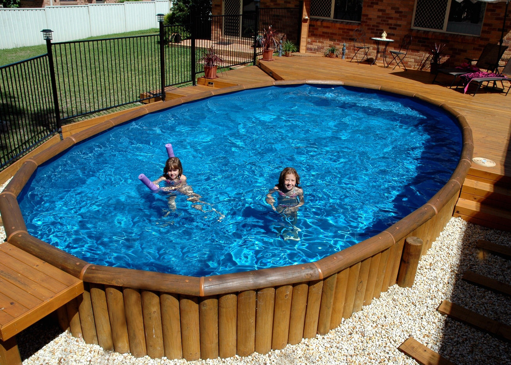 Wood decks around above ground pools pool design ideas for Above ground pool decks with hot tub