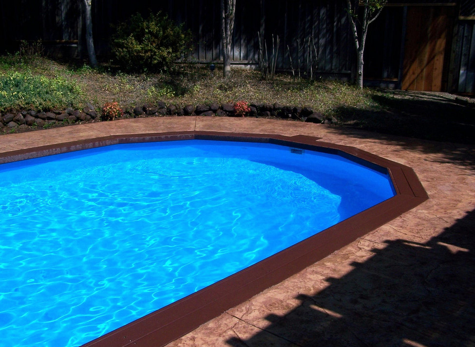 Above ground inground pools a good comparison of two for Best type of inground pool