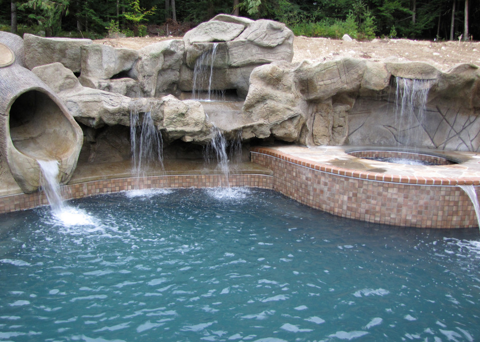 Pool waterfall design ideas pool design ideas for Large swimming pool designs