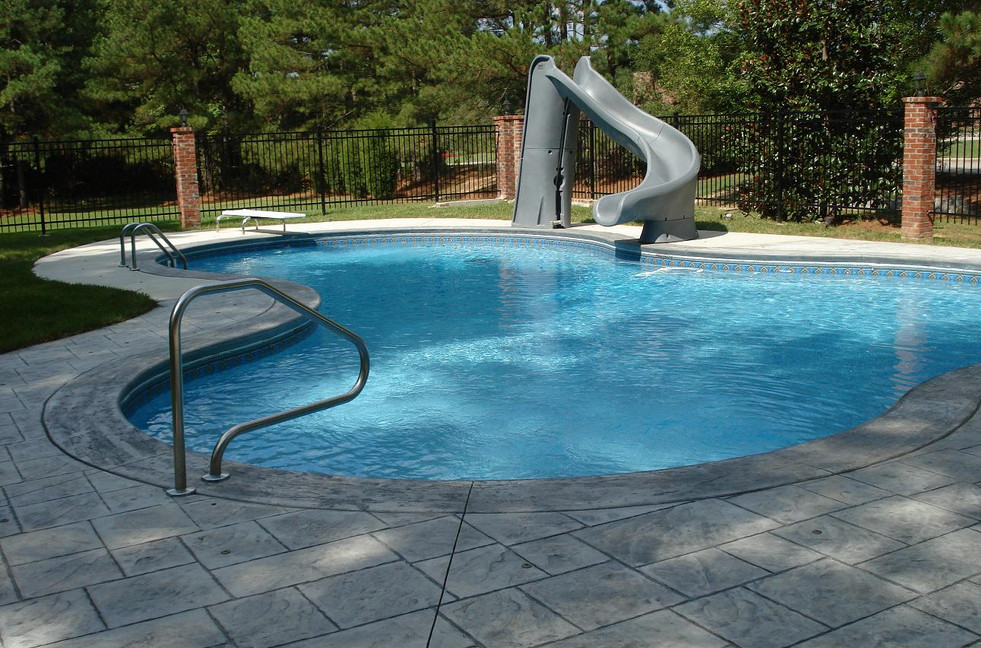 Residential swimming pool slides pool design ideas for Pool design with slide
