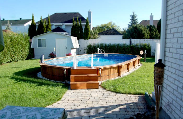Semi inground pool landscape ideas pool design ideas for Swimming pools ideas landscape