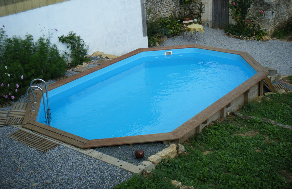 Building an inground pool on a sloped yard round designs for Building an inground pool