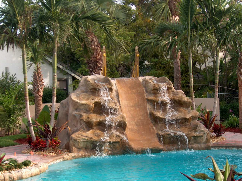 Swimming pool waterfalls water features pool design ideas for Pool design with slide