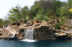 Swimming Pools With Waterfalls and Slides